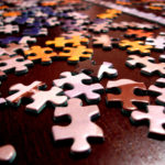 puzzle pieces to represent working together